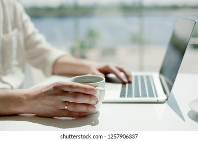 Businessman working laptop for new architectural project. Generic design notebook on the table. Young businessman working with laptop at office. Unrecognizable man using a modern portable computer