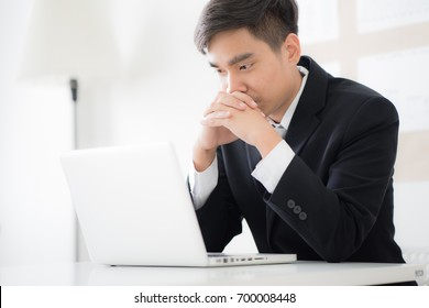 Businessman working laptop in office. Asian people