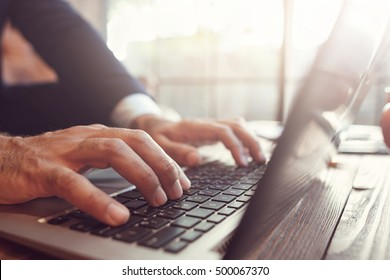 businessman working at laptop. Unrecognizable man typing text on the keyboard. Business, work, author, writer, creative concept