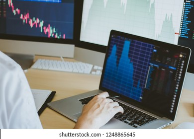 businessman working and looking directions change Average line Share price movement Stock trading in the up and down. On the display screen Computer