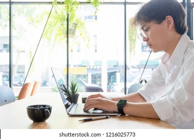 businessman working with mobile laptop and documents in office, business concept