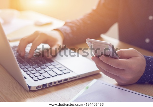 businessman working with modern devices, student boy using digital tablet computer and mobile smart phone,business concept,selective focus,vintage color