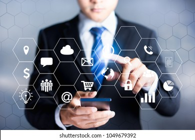 Businessman working with modern devices,Internet of things - IOT and digital marketing via multi-channel communication network on mobile smart device application technology