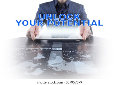 Businessman working with modern tablet PC and presenting unlock your potential concept.