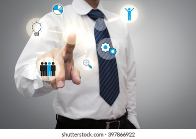 Businessman working with modern virtual technology, hand touching pointing to businessman icon in the middle that linked with each other as network - HR,HRM,HRD, teamwork & leadership concept