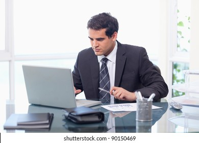 Businessman working with a notebook in his office