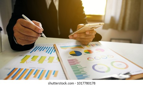 Businessman working in the office. business report graphs