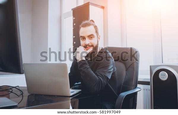 Businessman working In the office. Computer and laptop