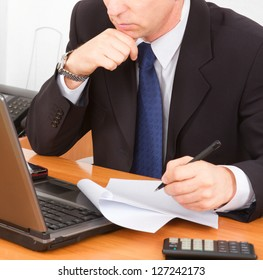 Businessman working in office, concept of control