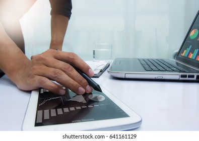 Businessman working at office. Digital tablet laptop computer smart phone using, keyboard. Connection internet application online. Finance manager. Banking. Professional investor.