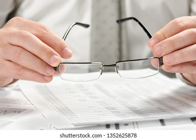 Businessman working in an office. Hands and documents closeup.