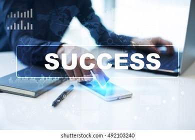 "Businessman is working in office, pressing button on virtual screen and selecting ""Success"". Business concept."