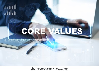 "Businessman is working in office, pressing button on virtual screen and selecting ""Core values"". Business concept."