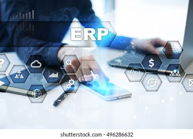 Businessman is working in office, pressing button on virtual screen and selecting erp