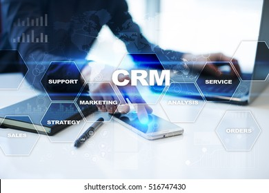 Businessman is working in office, pressing button on virtual screen and selecting crm.