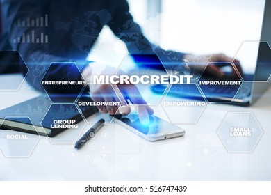 Businessman is working in office, pressing button on virtual screen and selecting microcredit.