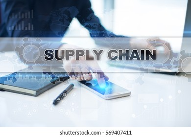 Businessman working in office, pressing button on virtual screen and selecting supply chain.