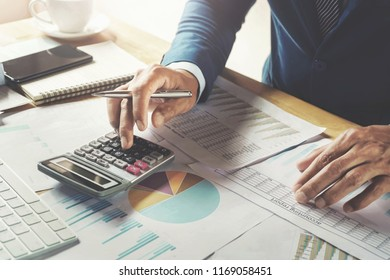 businessman working in office using calculator. finanace and accounting concept