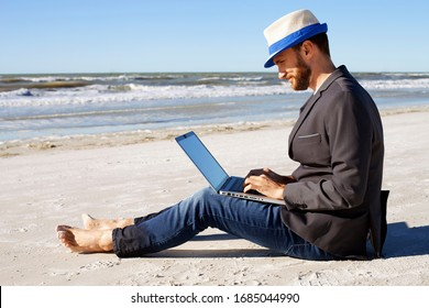 Businessman working on beach during his vacation.