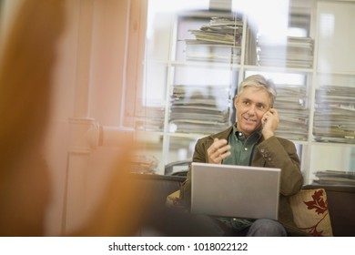 Businessman working on couch