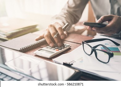 Businessman working on Desk office business financial accounting calculate
