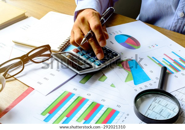 businessman working on Desk office business financial accounting calculate, Graph analysis