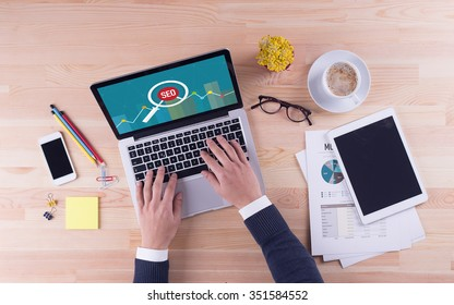 Businessman is working on desk -  SEO