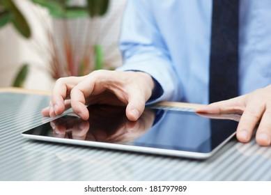 businessman working on digital tablet, closeup