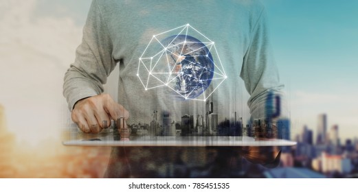 Businessman working on digital tablet with global network connection technology, city sunrise background. Element of this image are furnished by NASA