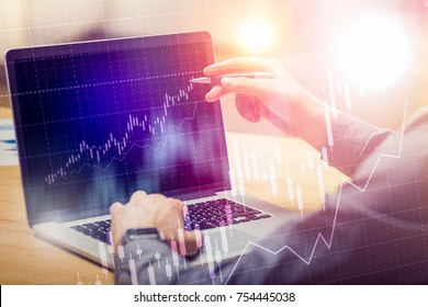 Businessman working on global financial trading growth analysis strategy using laptop.Modern business innovation investment concept.Office project with virtual forex graph and chart data interface.