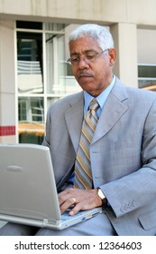 Businessman working on his computer in the downtown area