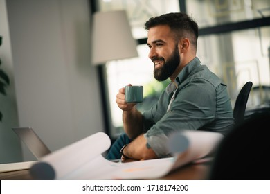 Businessman working on his laptop. Businessman drinking coffee and working.
