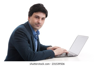 businessman working on his laptop computer. Isolated over white