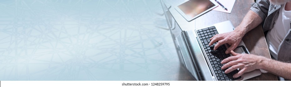 Businessman working on laptop in office. panoramic banner