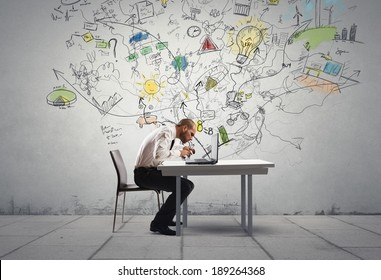 Businessman working on a new idea with a laptop
