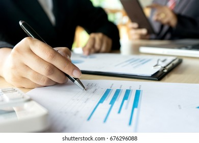 businessman working on paper to proof for maket plan