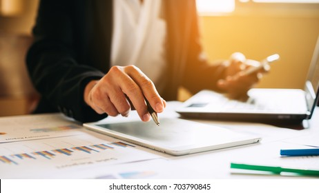 businessman working on project for analyzing company financial report balance statement with documents graphics at modern office space. Concept picture of business,economy, market,money and tax.