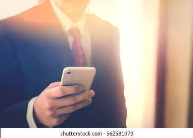 Businessman working on the smartphone