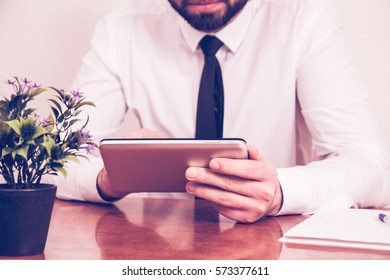 Businessman working on a tablet PC at the desk in the office