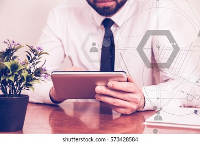 Businessman working on a tablet PC, drawn abstract connection structure