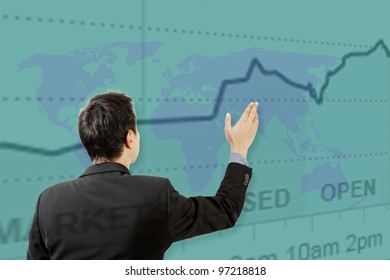 businessman working on touch screen and graph