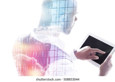 Businessman working on a touch-pad double exposure office tower and sky isolated on white
