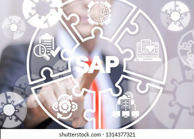 Businessman working on a virtual screen of the future and touches the icon: SAP. SAP - system software enterprise resource planning automation.