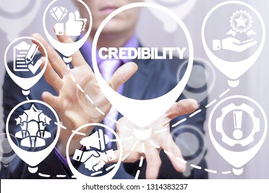 Businessman working on a virtual screen of the future and offers the inscription: credibility. Credibility, reputation and trust business concept.