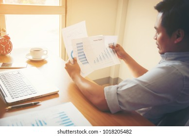 Businessman working with sheet analysis charts.
