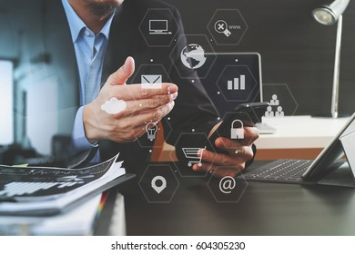 businessman working with smart phone and digital tablet and laptop computer in modern office with virtual interface graphic icons network diagram