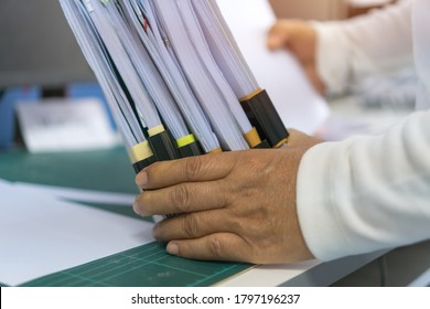 Businessman working stacks unfinished documents achieves, paperwork files for searching information at work office, business report papers, piles of investigate workload form for teacher in school