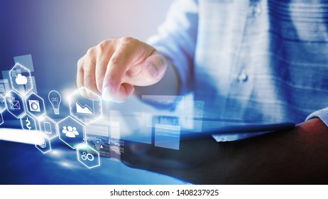 businessman  working with tablet modern technology  with social media icons on screen