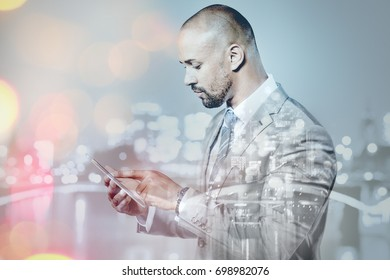 Businessman working with a touch pad double exposure