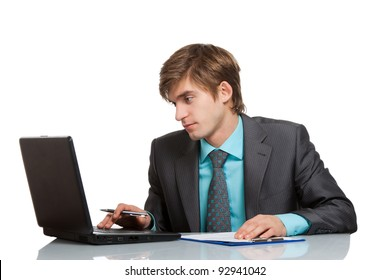 businessman working using laptop computer, handsome young businessman sitting at the desk wear elegant suit, isolated over white background.